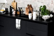 21 black cabinets and white bricks to add a textural look to the kitchen