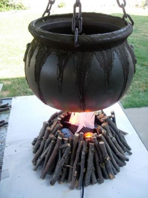 cauldron with sticks for outdoor Halloween decor