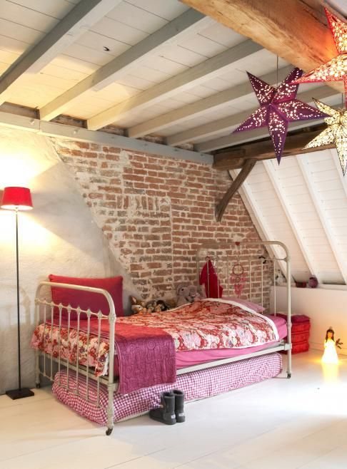 attic girl's space with a part brick wall that makes a statement