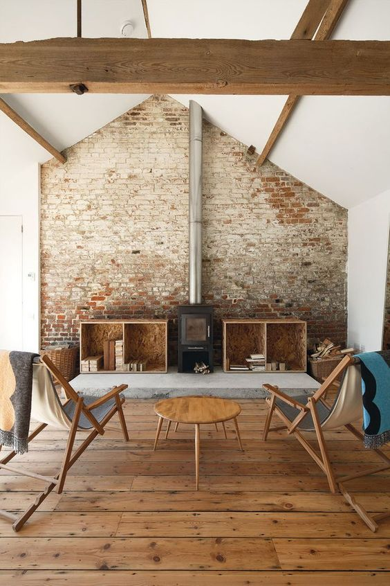 restored brick clad with a stove for safety and to accentuate it