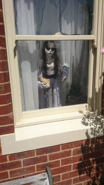 scary child standing by the window is a cool and frightening idea