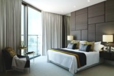 22 upholstered panel wall makes this bedroom modern and chic