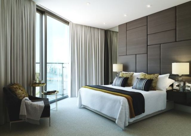 upholstered panel wall makes this bedroom modern and chic