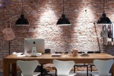 23 a minimalist home office is accentuated with rough brick
