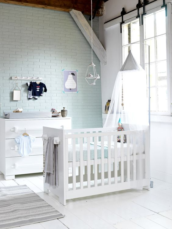 mint brick wall blends with neutral and subtle nursery decor