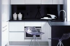 23 tiny kitchen with a glossy black backsplash and transparent stools