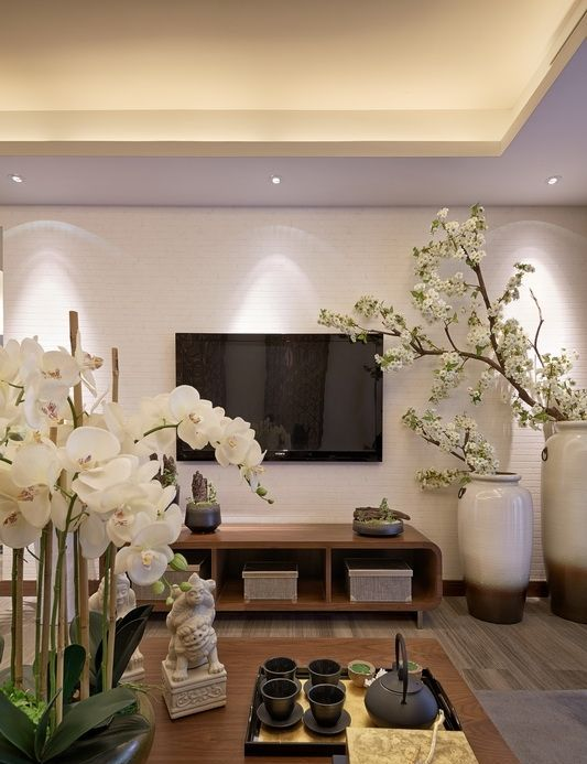 white orchids and white silk cherry blooms give a Chinese feel