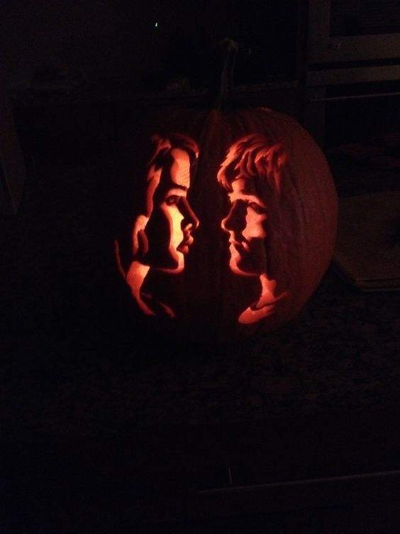 Katniss and Pete pumpkin carving