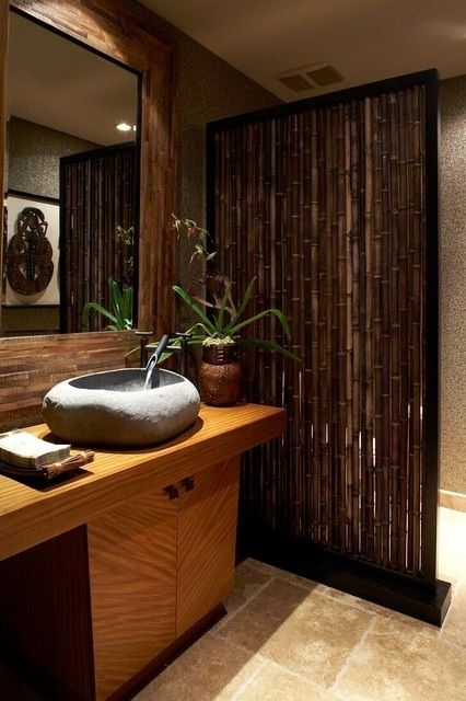 bamboo space divider, a stone sink for a spa-like bathroom