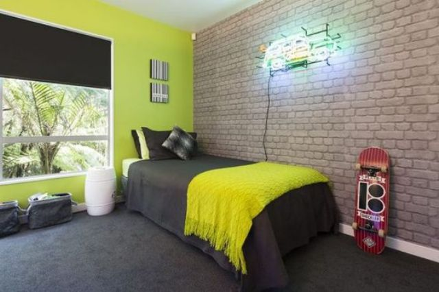 exposed brick highlights that it's a boy's room and contrasts with neon