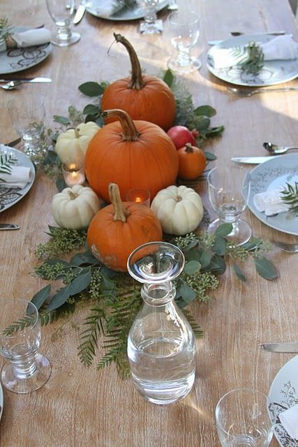 natural pumpkins with greenery and leaves placed right on the table