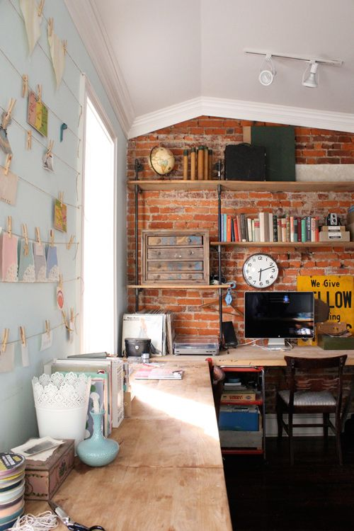 Simple Exposed Red Brick Blends Perfectly With This Industrial Office