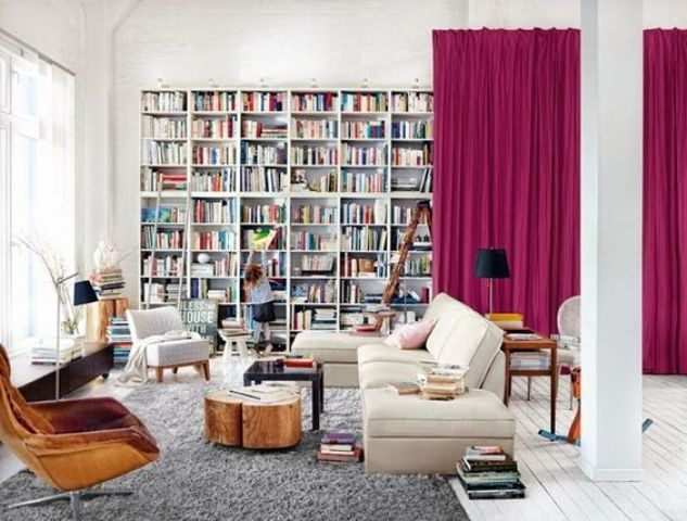 bold pink curtains that hide a whole library