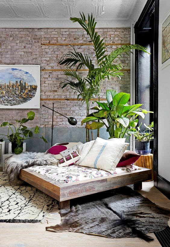brick accent wall brings chic and texture to the room