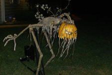 25 freaky Halloween figure with a pumpkin head