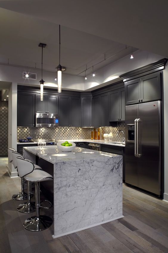 grey shaker cabinets look pulled off with a neutral-colored marble countertop