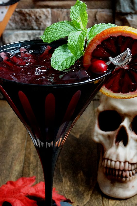 bloody zombie rum cocktail with a pirate-themed stirrer