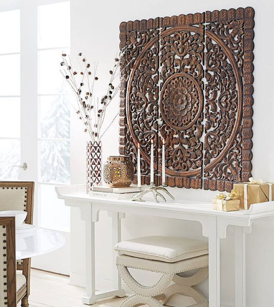 carved wood wall art panel is a bold piece and is organic