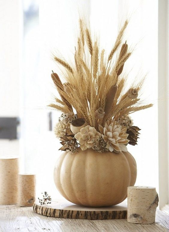 pumpkin vase with faux flowers, wheat