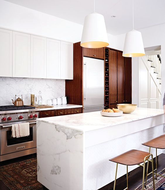 serene marble countertop spruces up a traditional wwooden kitchen