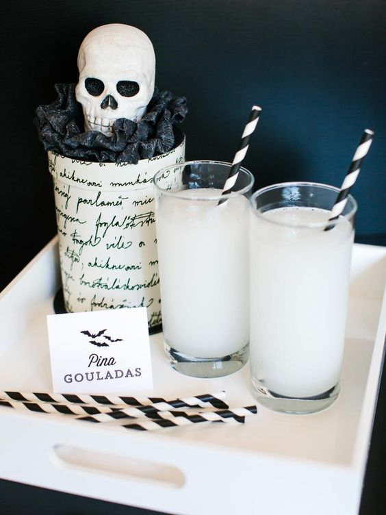 Pina Ghouladas and a black Raven-inspired glass