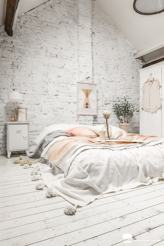 airy white bedroom with whitewashed brick to make it more original-looking