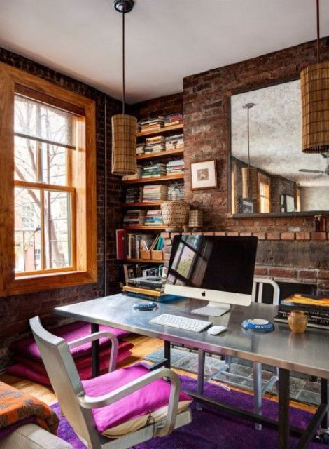 bold eclectic home office with brick walls for a unique look
