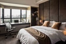 27 rough dark fabric adds a masculine touch to the space