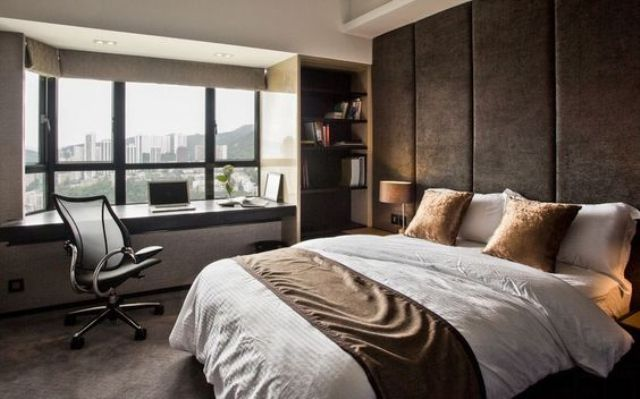 rough dark fabric adds a masculine touch to the space