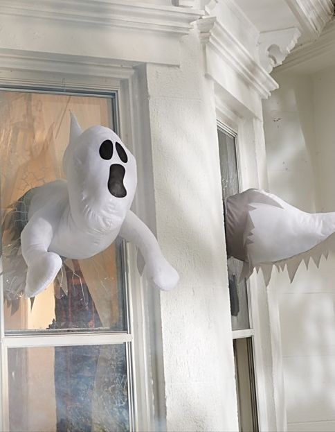 window crasher ghosts that appear inside and outside will give your window decor a new dimension