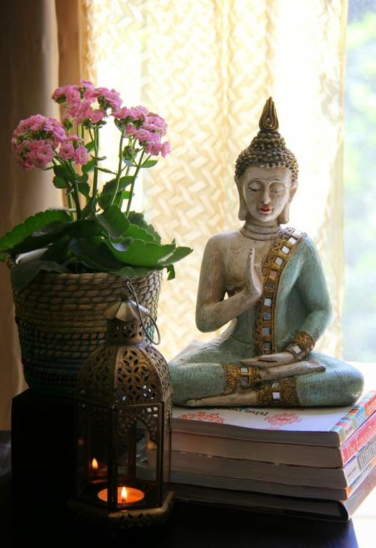 Buddha, a hand mudra and an unpretentious orchid bring a zen feel