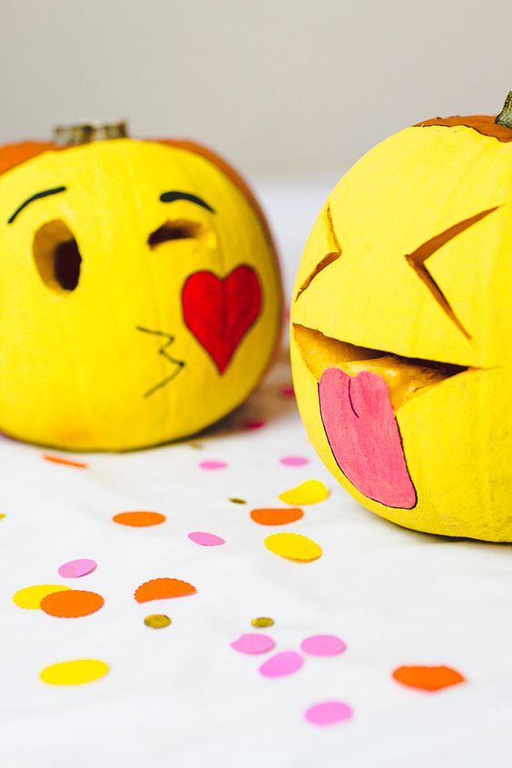 painted and carved emoji pumpkins