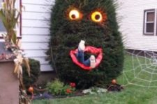 28 people-eating Halloween tree with lighted eyes