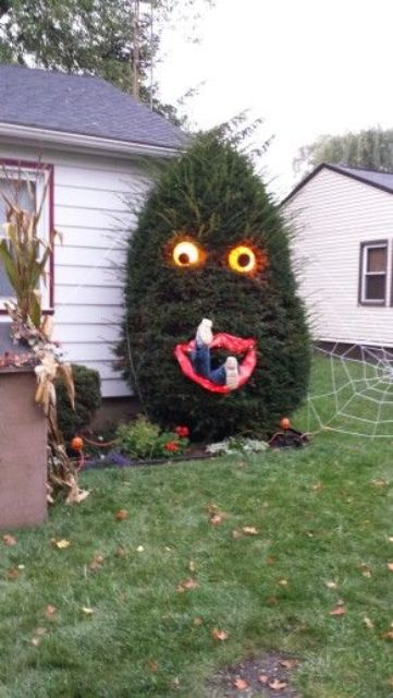 people-eating Halloween tree with lighted eyes