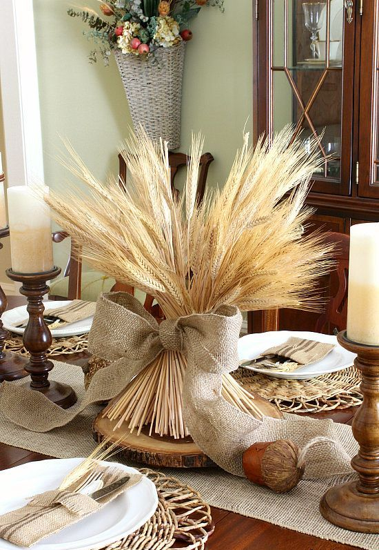 wheat with a burlap bow on a wooden slice is an ideal no fuss centerpiece