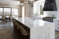 29 enjoy the durability of marble using it not only for a waterfall countertop but also for backsplashes