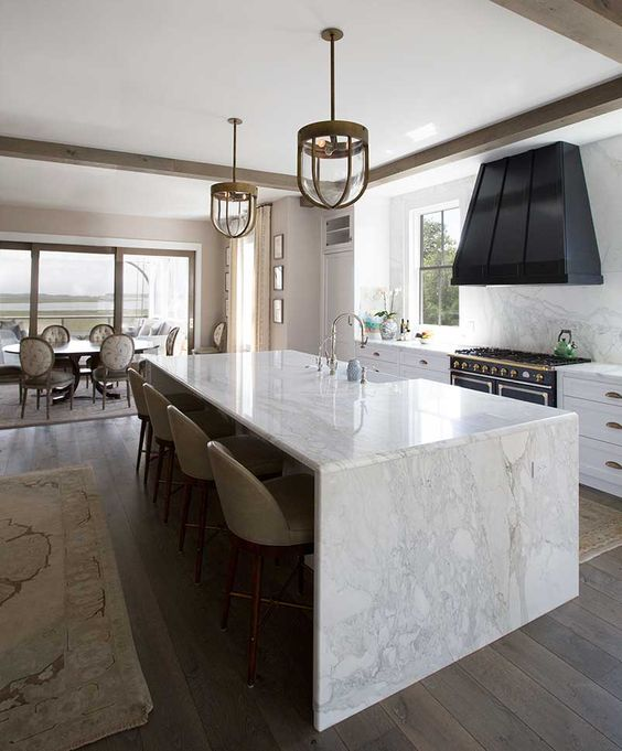 enjoy the durability of marble using it not only for a waterfall countertop but also for backsplashes