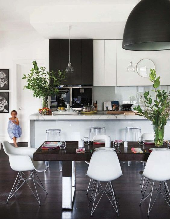 greenery in vases enlivens this monochrome space