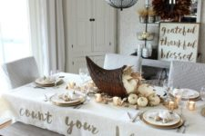 29 white tablescape with a large cornucopia and white pumpkins