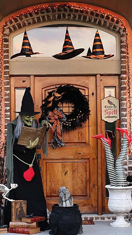 witch with a cauldron at the door to welcom guests - Halloween Witch Decoration
