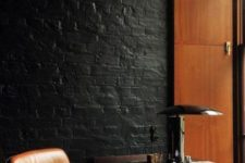 30 mid-century modern office with warm woods and leather is accentuated with a black brick wall