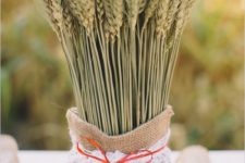 30 wheat in a burlap sack with a lace tie is a cool rustic idea