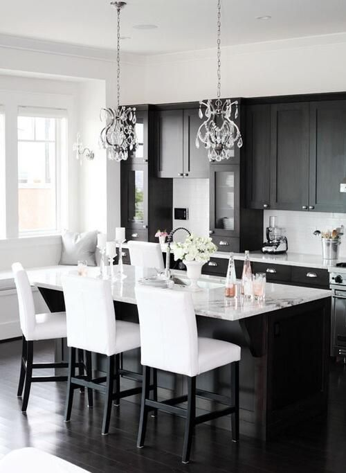 black kitchen cabinets with white countertops look perfect together