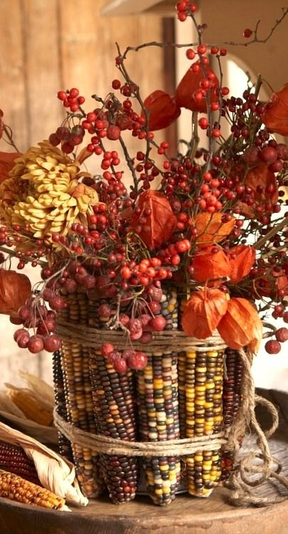 corn tied up with twine, flowers and berries