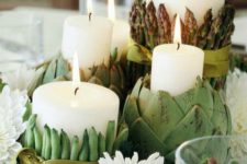 32 dish centerpiece with candles covered with artichokes, asparagus and peas
