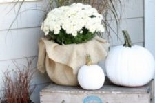 32 outdoor crate display with white pumpkins and potted flowers