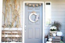 33 neutral fall decor, white pumpkins, corn stalks, vintage farm house signs, a fabric wreath, burlap bunting