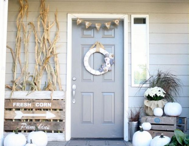 neutral fall decor, white pumpkins, corn stalks, vintage farm house signs, a fabric wreath, burlap bunting