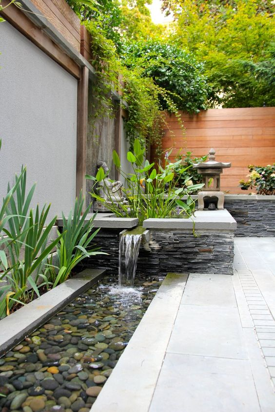 a garden waterfall can be spruced up with pebbles to look more Asian-like