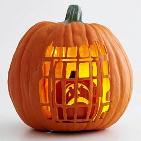 pumpkin cage with a smaller pumpkin inside